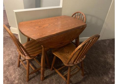 Solid wood table with fold down sides